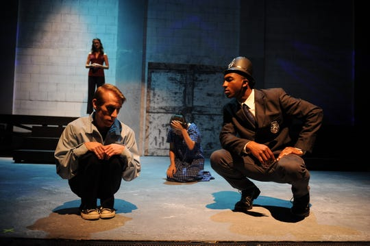 """Christopher (Matthew Thompson) recalls the horrible morning involving a police officer (Jonathan Horton) and a dead dog in TheatreTCC's production of """"The Curious Incident of the Dog in the Night-Time."""""""