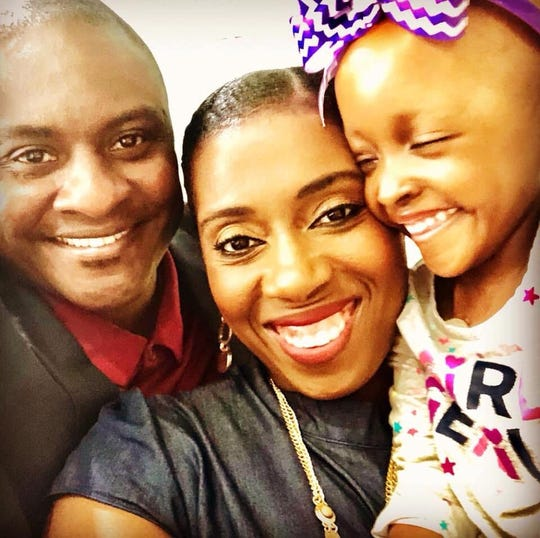 Two-year-old Jae Alexia Jackson with her parents Dee and Clarence Jackson