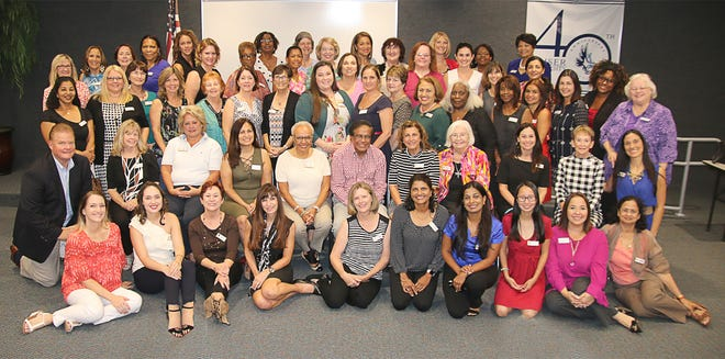 Impact 100 St Lucie's 120 founding members recently gathered at Keiser University.
