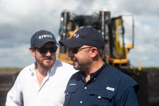 """South Florida Water Management District staff, Federico Fernandez (left), board chairman and Ernie Marks, executive director, along with others, announced preliminary construction of the EAA reservoir on a 560-acre tract of land at a news conference Wednesday, Nov. 14, 2018 in western Palm Beach County. Fernandez said the water management district is """"expediting this"""" project because it's """"absolutely necessary"""" to move forward with constructing the 23-foot deep, 10,100-acre reservoir that will be able to store up to 78.2 billion gallons of excess Lake Okeechobee water. """"Delaying is not an option,"""" Fernandez said."""