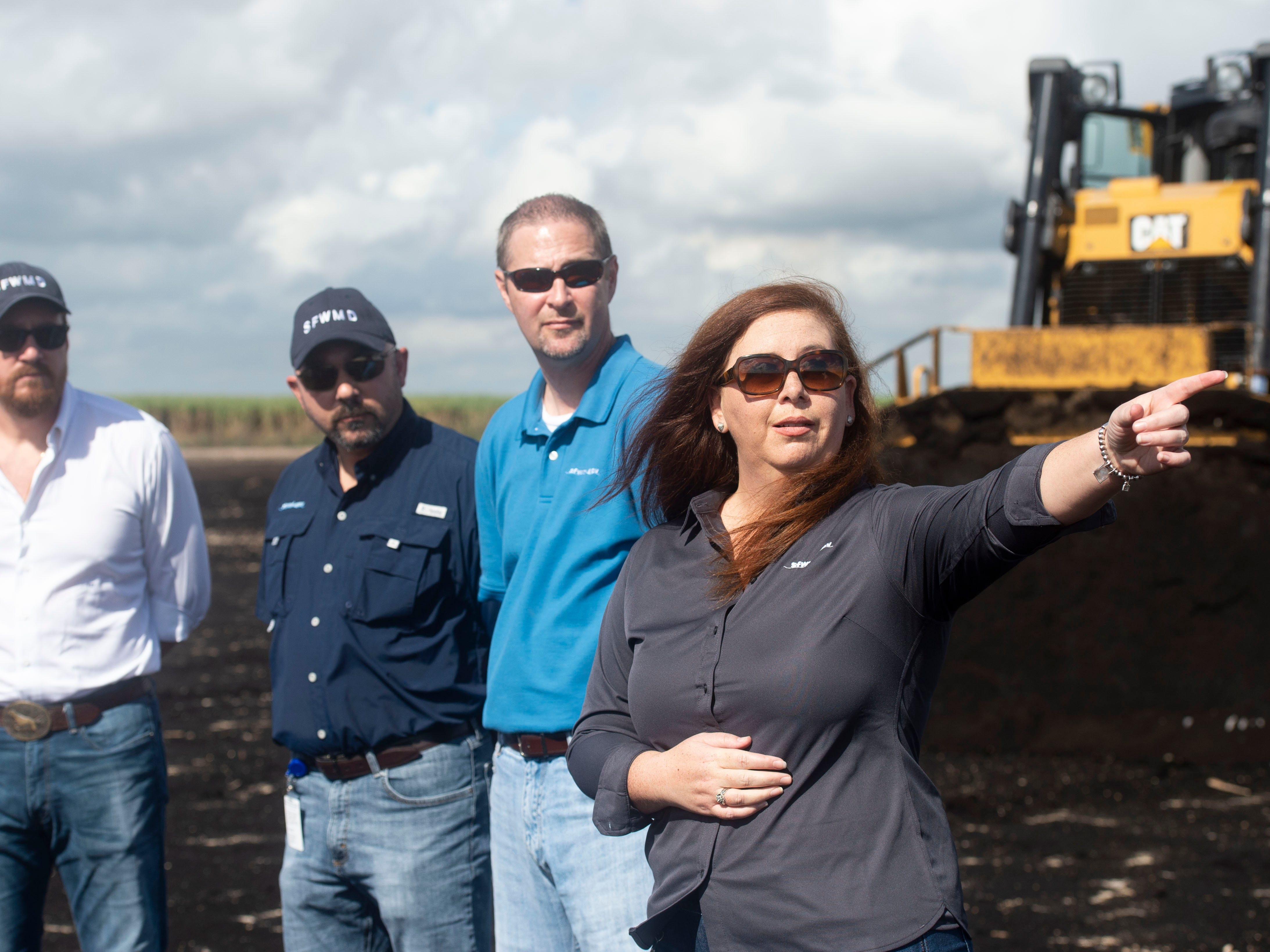 "South Florida Water Management District staff (from left), Federico Fernandez, board chairman; Ernie Marks, executive director; John Mitnik, chief engineer; and Eva Valez, director of Everglades policy and restoration, announced preliminary construction of the EAA reservoir on a 560-acre tract of land at a news conference Wednesday, Nov. 14, 2018 in western Palm Beach County. Fernandez said the water management district is ""expediting this"" project because it's ""absolutely necessary"" to move forward with constructing the 23-foot deep, 10,100-acre reservoir that will be able to store up to 78.2 billion gallons of excess Lake Okeechobee water. ""Delaying is not an option,"" Fernandez said."