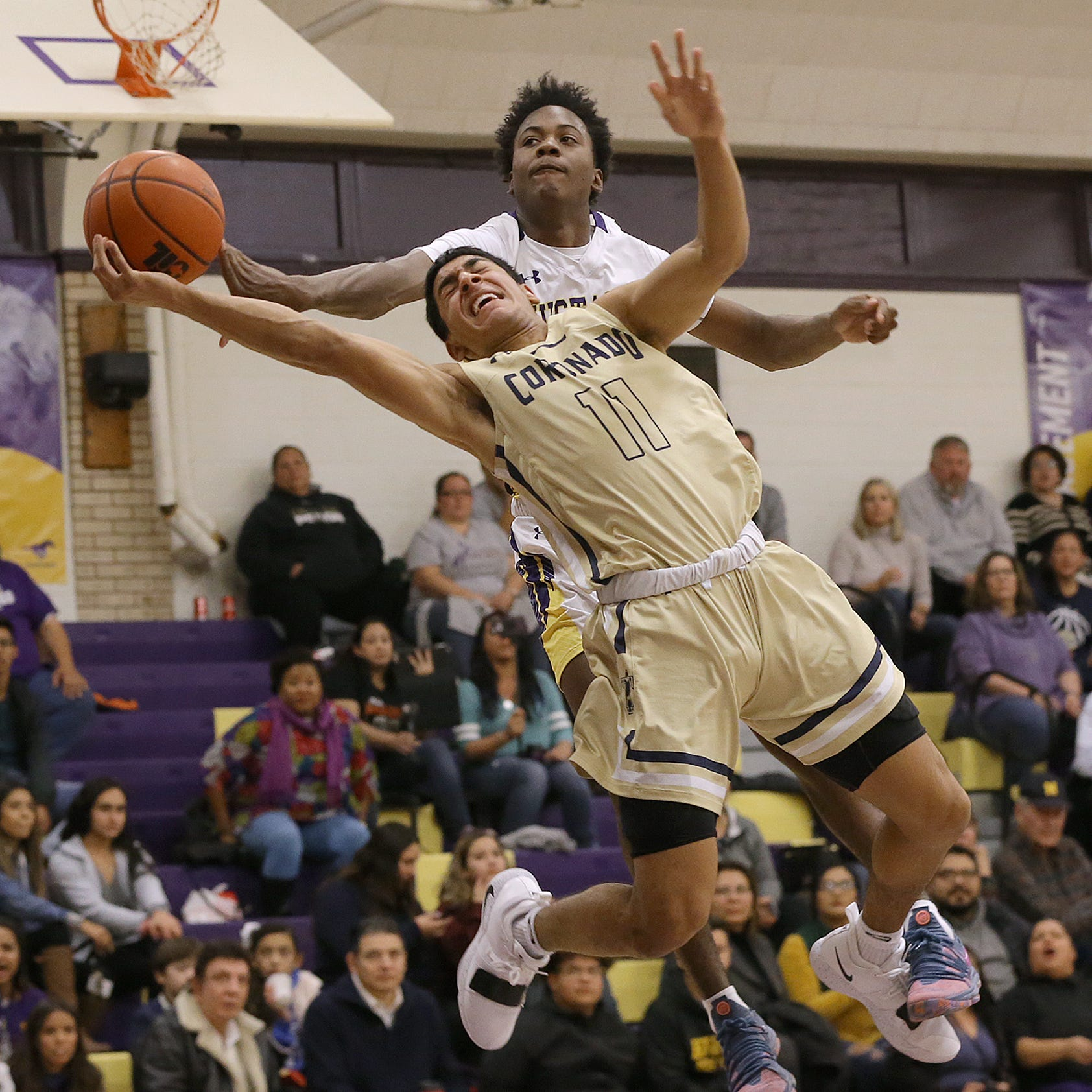 Burges forward Tristen Newton blocks a shot by Coronado's Ayaan Sohail during their game recently at Burges High School. Burges defeated Coronado 73-56.