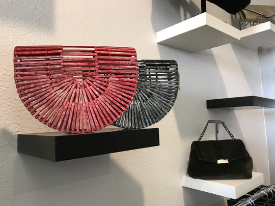 These trending acrylic basket bags are great gift ideas for young women. $90. Wood styles are $50. Available at V & X Boutique, 3800 N. Mesa St.