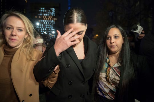 """Emma Coronel, center, the wife of Joaquin """"El Chapo"""" Guzman, leaves Brooklyn, New York, federal court Tuesday after opening arguments in the trial of the alleged Mexican drug lord."""