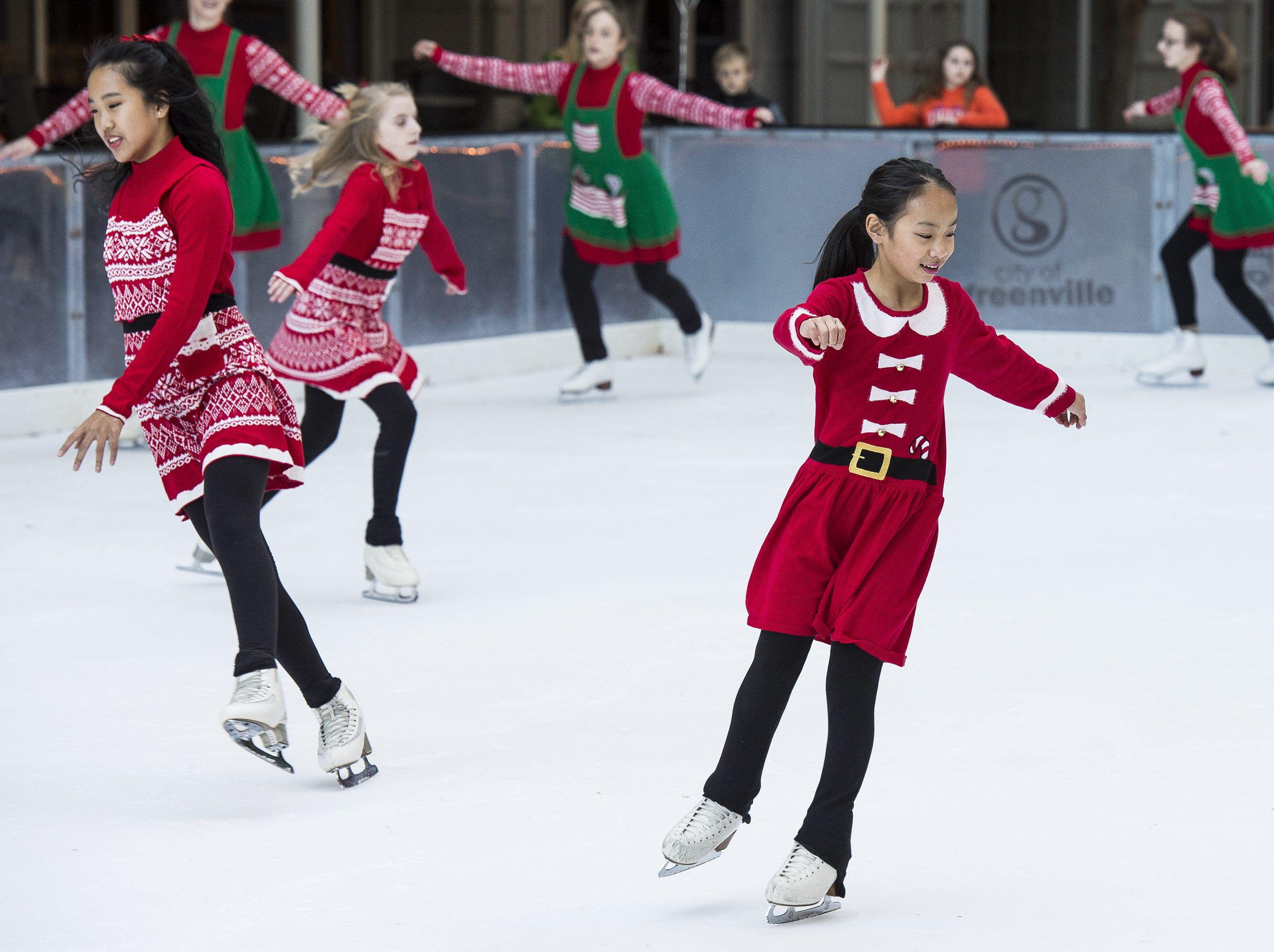 Sabrina Yang, right, and other members of the Greenville Figure Skating Club perform during the official opening of the United Community Bank Ice on Main ice skating rink in 2017. The rink opens again this weekend.
