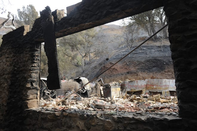 A home in the Santa Monica Mountains above Leo Carrillo State Park was destroyed by the Woolsey Fire. Portions of the charred mass stood Tuesday.