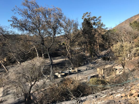 Burned vehicles and brush are seen Wednesday at Camp Hess Kramer near Yerba Buena Road. The camp is operated by the Wilshire Boulevard Temple in Los Angeles and was severely damaged by the Woolsey Fire.