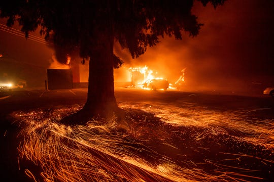 Flames consume a Kentucky Fried Chicken as the Camp Fire tears through Paradise on Nov. 8.