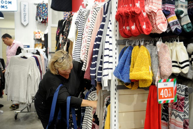 Traci Schiller, of Ventura, shops at Old Navy at the Camarillo Premium Outlets. Schiller says in addition to shopping on Black Friday, she likes to watch people.