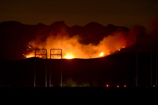 Fire moves over a ridge near California State University Channel Islands on Tuesday night after strong winds caused several flare-ups as the Woolsey and Hill fires continued to burn in Ventura County.
