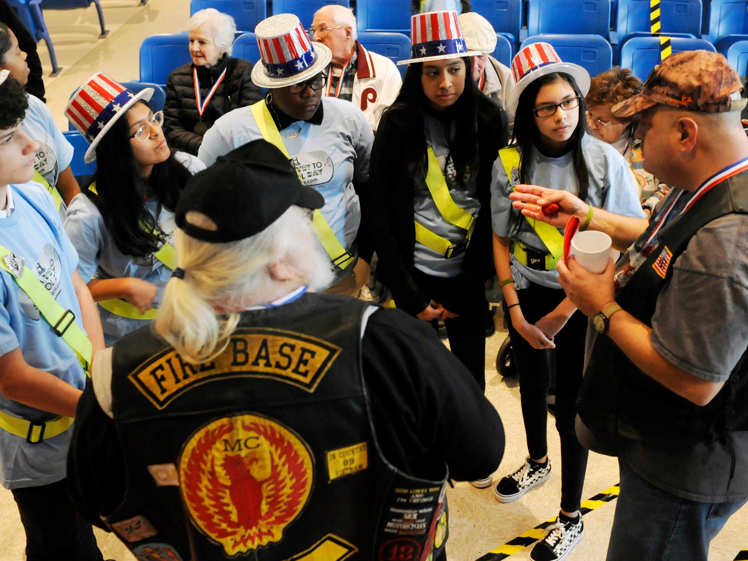 Veterans Memorial School staff and students honored local veterans during a special assembly. Students gave attendees handmade pin and thread art representing a rose and a school medal. Over 30 veterans attended the event on Wednesday, November 14, 2018.
