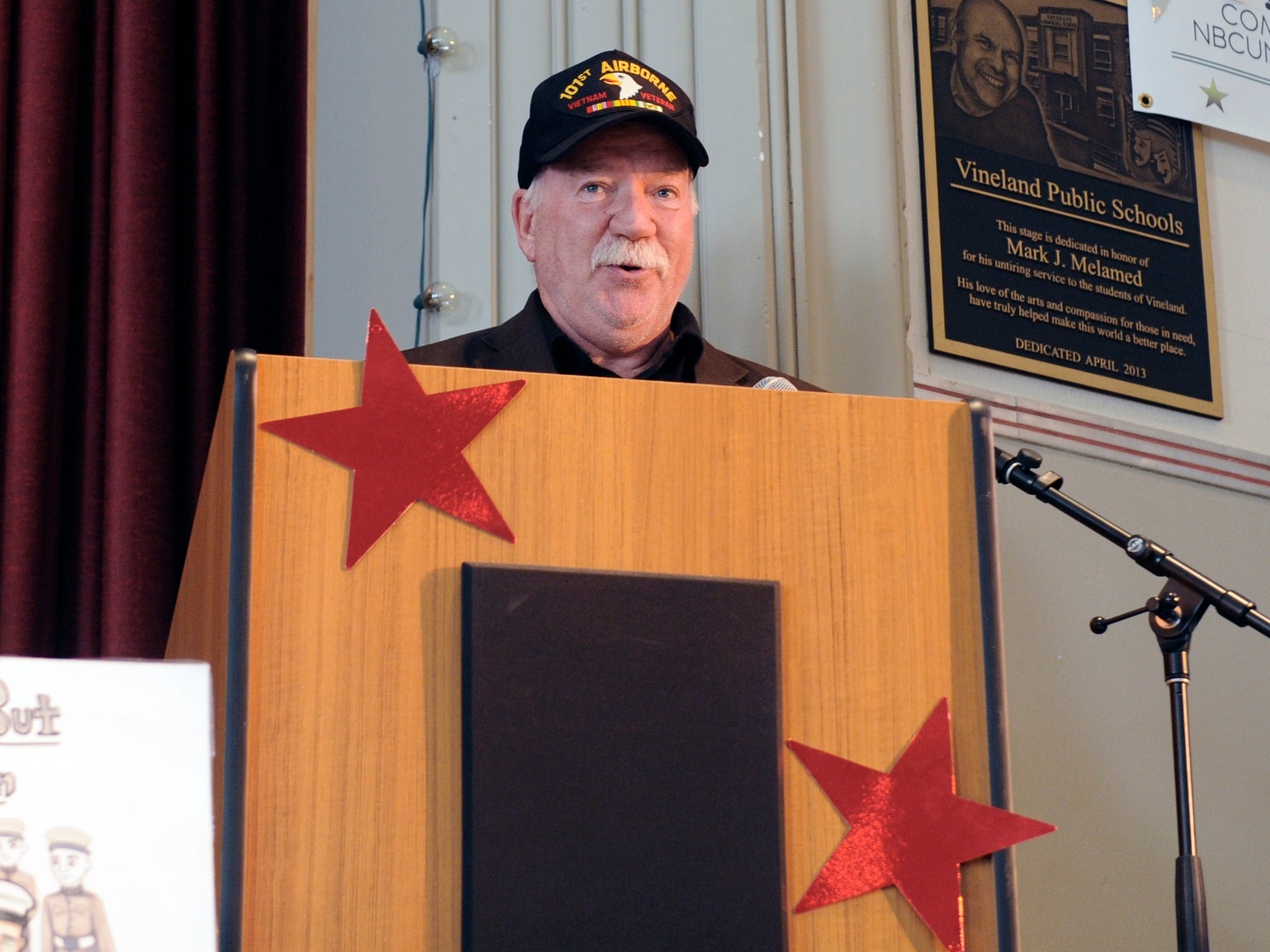 Vietnam Veteran and State Assemblyman Bruce Land speaks during a special assembly honoring heroes at Veterans Memorial School on Wednesday, November 14, 2018.