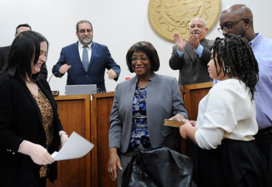 Elizabeth Arthur is sworn in as the newest member of Vineland City Council by Deputy Municipal Clerk Christine Scarpa while her son Dale Arthur Jr., and granddaughter Hannah Garrison, 10, hold the bible at city hall on Tuesday, November 13, 2018.