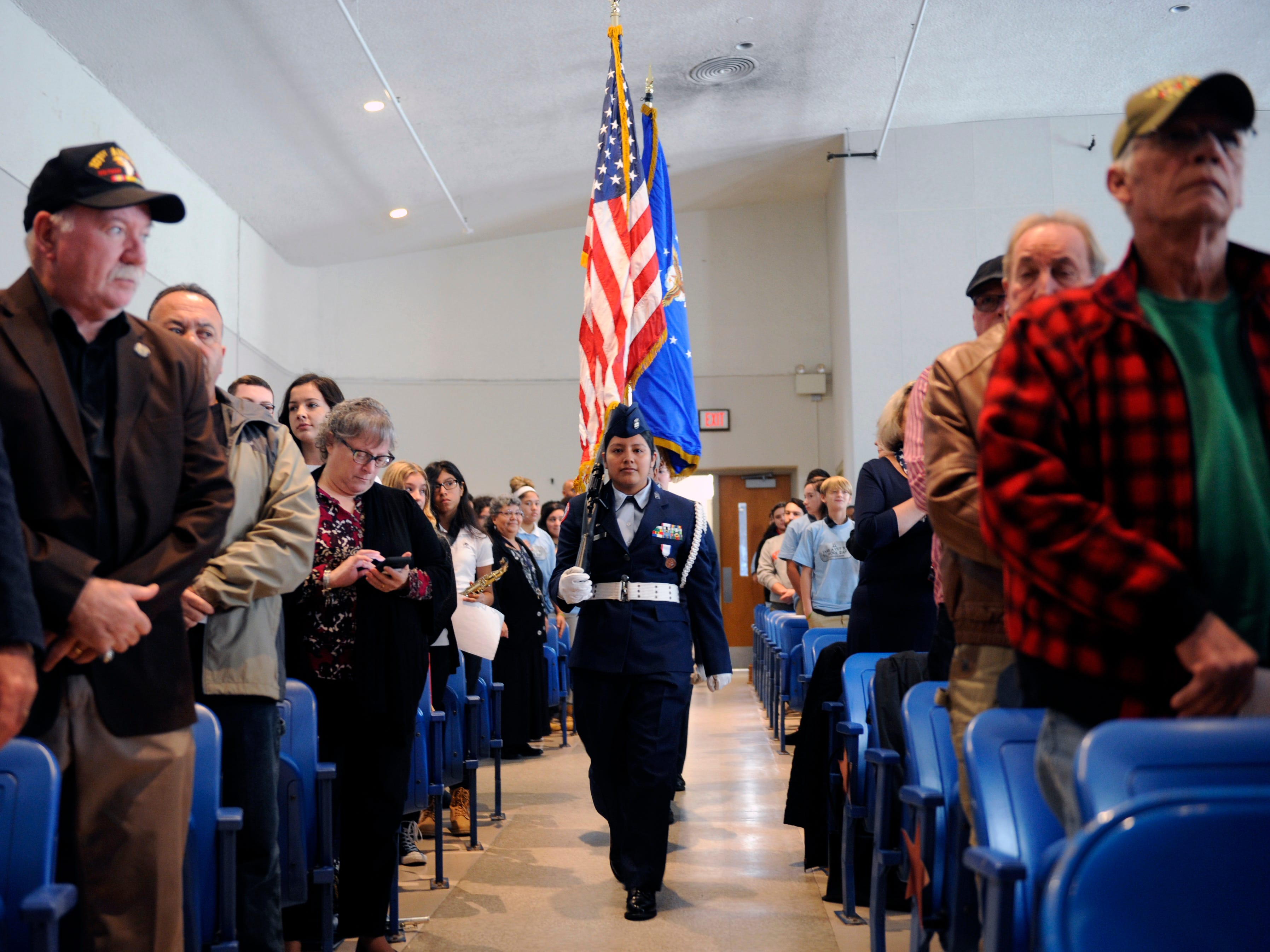 Mirian Marcial, Vineland High School Air Force Junior ROTC member carries the American flag during a special assembly honoring heroes at Veterans Memorial School on Wednesday, November 14, 2018.