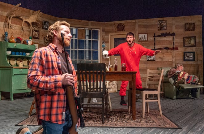 Aaron Johnson, left, Hank Boone, and Chad Homan rehearse for Escanaba in Da Moonlight at the Ice House Theater on Tuesday, November 13, 2018.