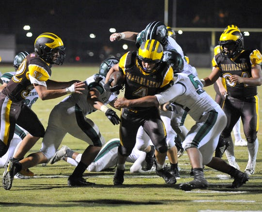 Golden West's Lonnie Wessel fights for yardage against El Diamante in the Battle for the Saddle game at Groppetti Stadium on October 26, 2018.