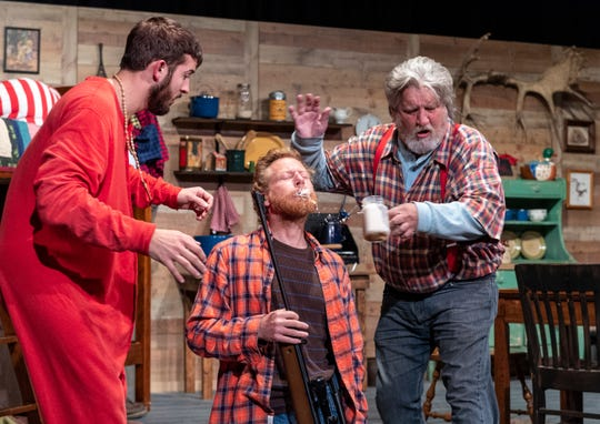Hank Boone, left, Aaron Johnson and Chad Homan rehearse for Escanaba in Da Moonlight at the Ice House Theater on Tuesday, November 13, 2018.