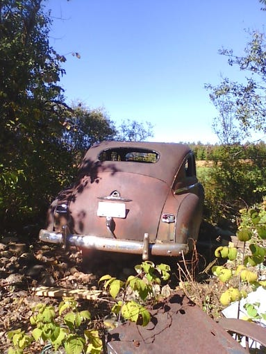 This 1948 Plymouth P15 Deluxe sedan sat on a rock pile for about 50 years.
