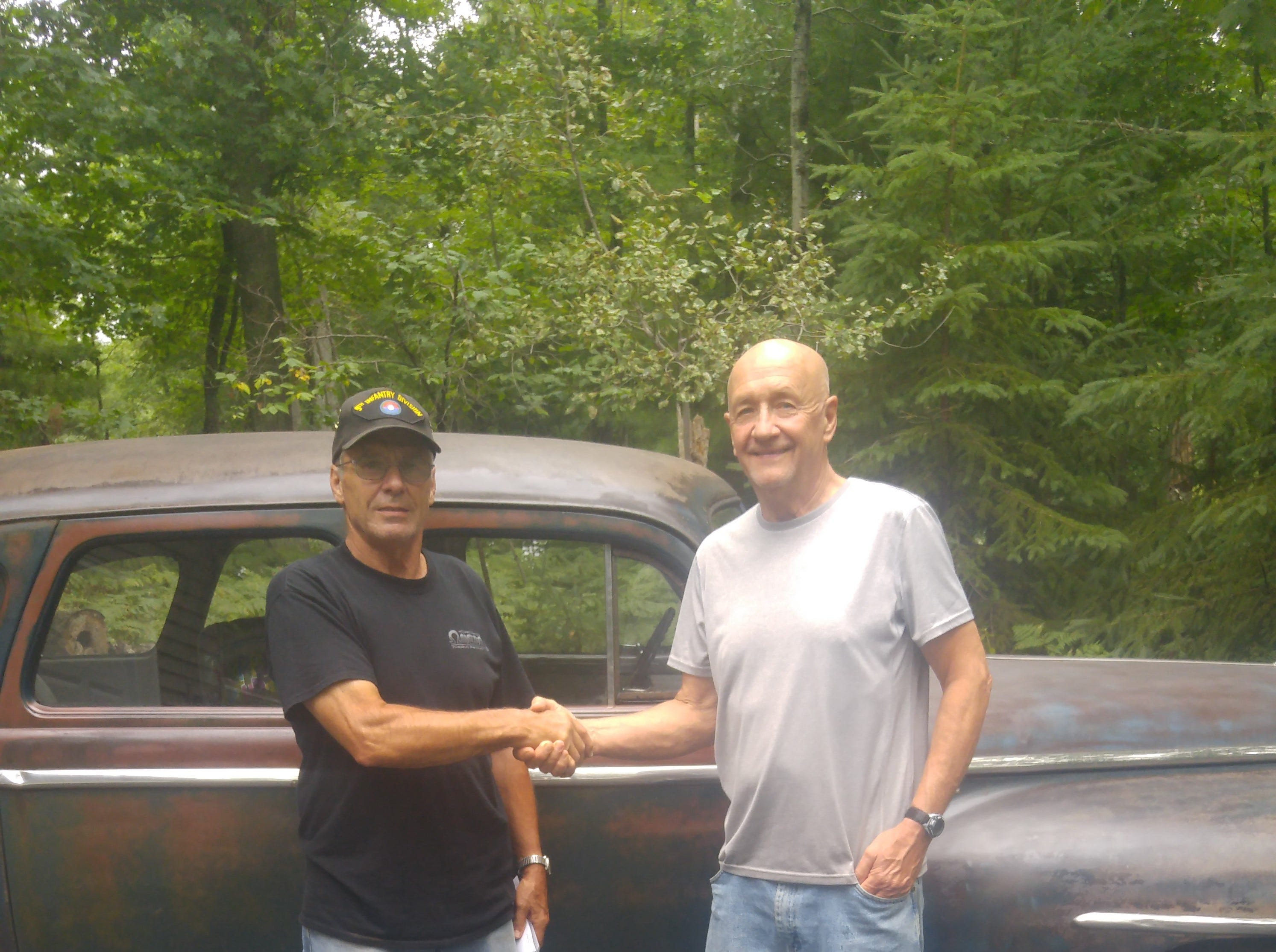 The vehicle was won by Randy Wendt (right) of Minocqua. He owned a '48 Plymouth when he was a teenager. But he didn't need the car today; he needed a more reliable, everyday driver.
