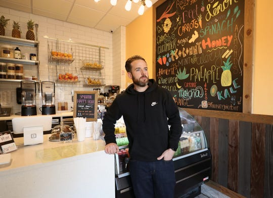 Ryan Knapp, co-owner of Root and Vine Juice Bar in Bronxville, is pictured in the shop, Nov. 14, 2018. The other co-owners are his wife, Cristina and father-in-law, Michael Pellegrini.