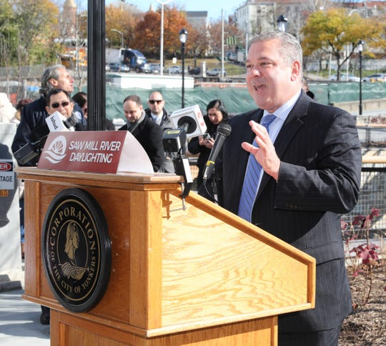 Yonkers Mayor Mike Spano addresses the crowd, as phase 3 of the Saw Mill River Daylighting is opened at Nepperhan Avenue and New Main Street, Nov. 14, 2018.