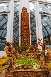 """The Channel Gardens at Rockefeller Center are executed in fine detail as part of the New York Botanical Garden's """"Holiday Train Show."""""""