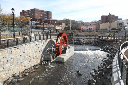 """Yonkers, New York, removed a parking lot to open up the Saw Mill River — a process known as """"daylighting"""" — shown here on Nov. 14."""