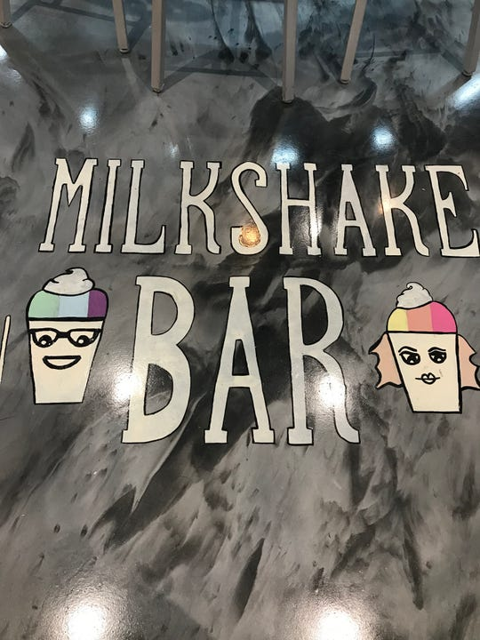 Signage on the floor at the new Bona Bona Ice Cream Shop lets you know you've entered the mllkshake bar area.