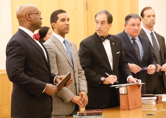 Mayor Richard Thomas, second from left, appears Wednesday at the Westchester County Courthouse in White Plains. He is flanked by his lawyers.