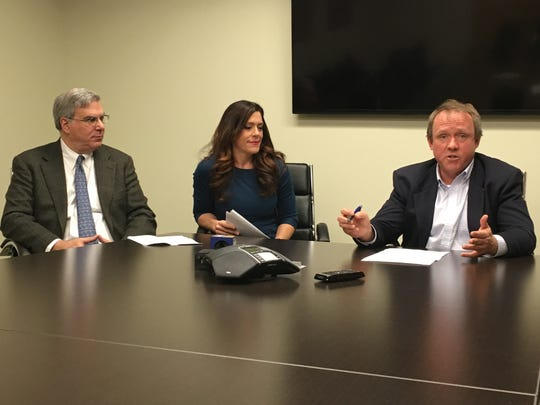 AAA New York Legislative Committee Chairman John Corlett, right, discusses New York's poor road conditions during a meeting at the Business Council of Westchester in Rye Brook on Nov. 14, 2018. Also discussing the conditions: Business Council of Westchester Executive Vice President and COO John Ravitz, left, and TRIP Associate Director of Reseach and Communications Carolyn Bonifas Kelly.