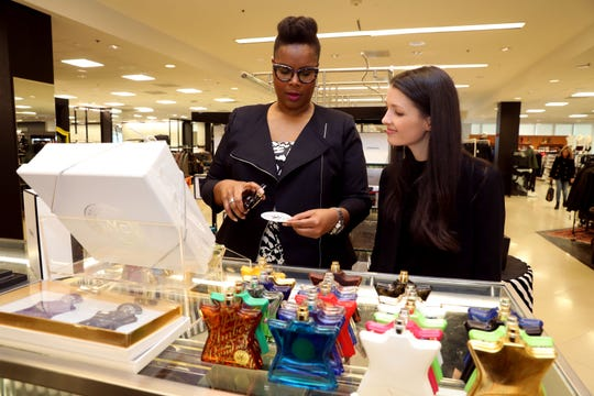 Personal shopper Kendra Porter shows marketing and events manager Becky Ginsburg men's fragrances at Bloomingdale's in White Plains Nov. 14, 2018. From personal wardrobe to corporate gifts to pajamas for grandkids, Porter's got shoppers covered.
