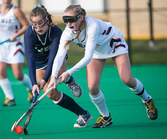 Morgan Fletcher (right) of Delmar battles with Maycee Collison of Lake Forest during last year's DIAA Division II field hockey semifinals. Fletcher is among the top players for the Wildcats, who are ranked first in Division II.