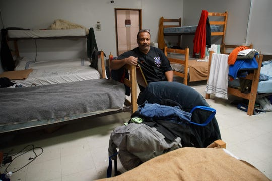 Robert Smith sits a room where he sleeps with other homeless men staying at SafeSpace Delaware, formerly known as the Rick VanStory Resource Center for the homeless.