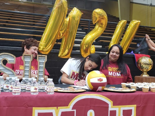 Rider senior Alyssa Estrada-Hamby signs a college letter of intent to play volleyball at Midwestern State.