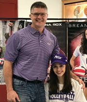 Brea Box celebrates signing day 2018 with her father, Bryan Box, at Holliday High School Wednesday. Box was the co-Most Valuable Hitter this year in District 8-3A. She also played on the national runner-up ZIVA team last summer.