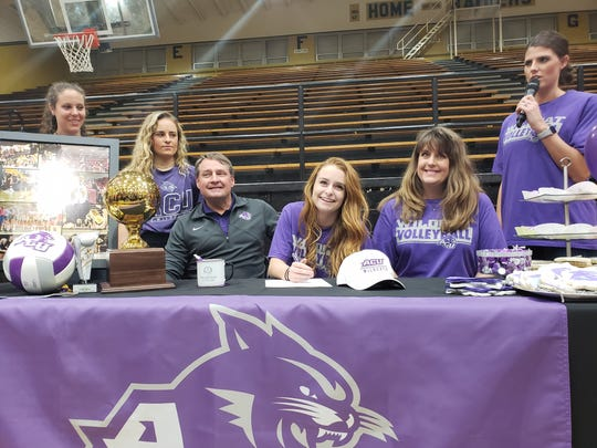 Rider senior Logan Browning signs a college letter of intent to play volleyball at Abilene Christian University.