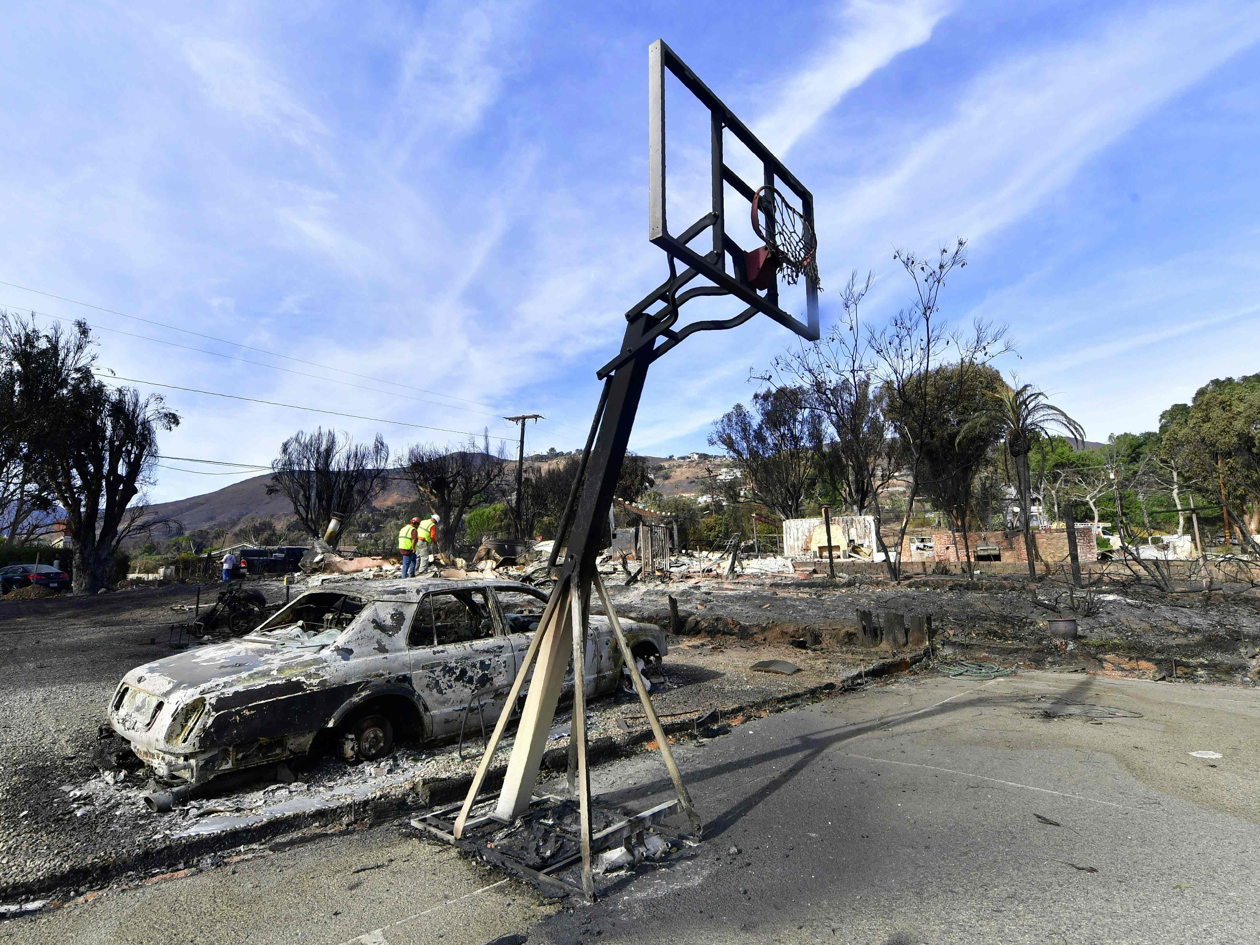 Workers check for gas lines amid the damaged homes from the Woolsey Fire on Filaree Heights Road in Malibu, Calif., on Nov. 13, 2018.