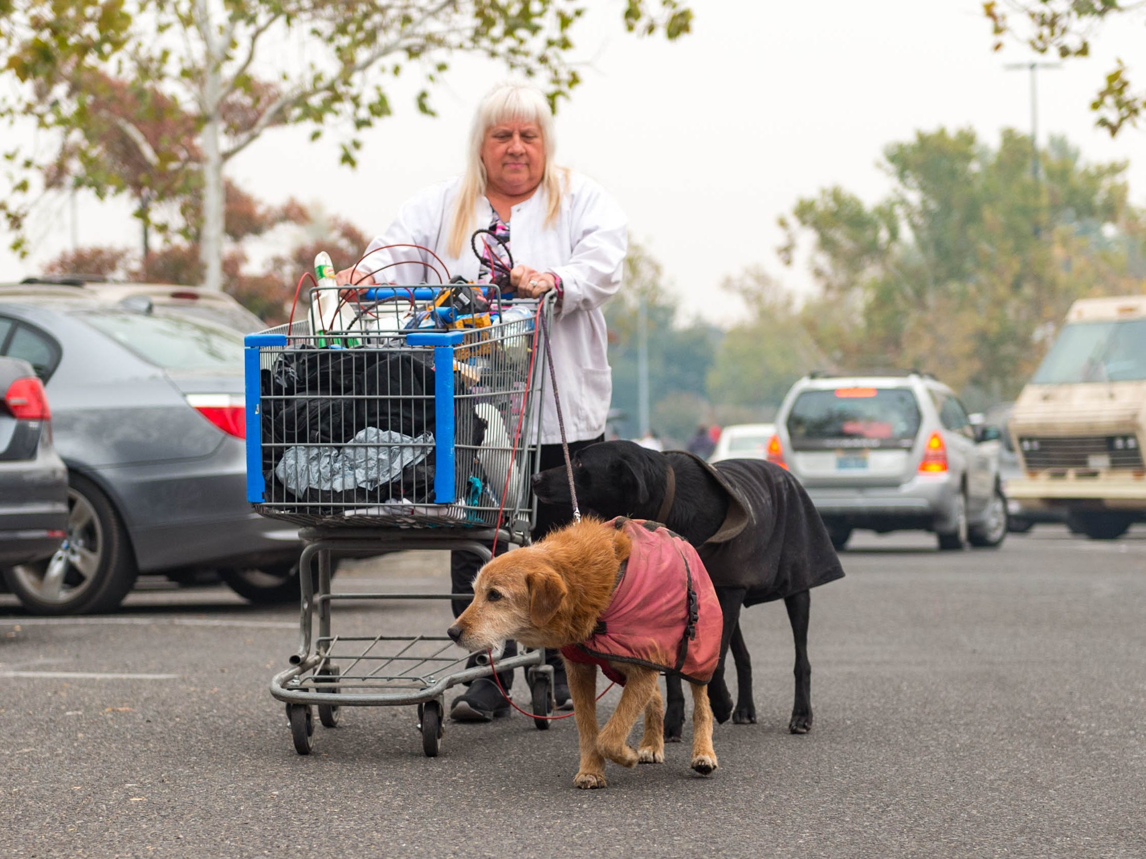 Residents of Paradise, Calif. create a temporary housing away from the fire in a Wal Mart parking lot in Chico, Calif. on Nov. 13, 2018.