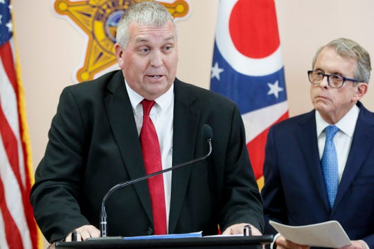 Pike County Prosecutor Rob Junk, left, speaks alongside Ohio Attorney General Mike DeWine, right, on Tuesday.