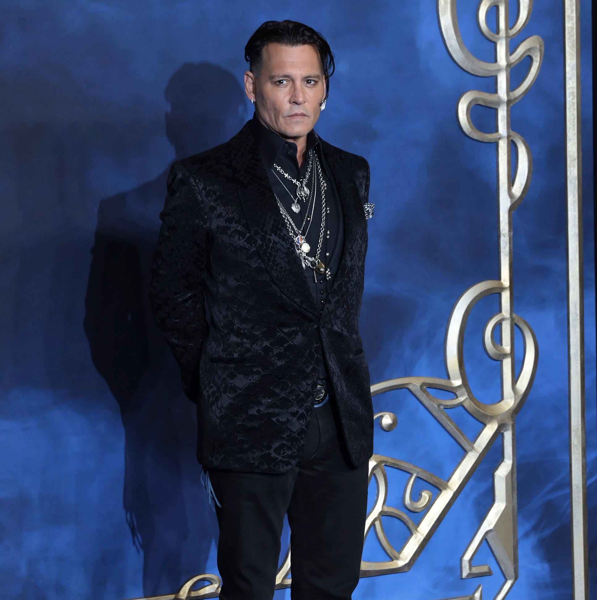 Cry-Baby, is that you? Depp (finally) walks 'Fantastic Beasts' carpet