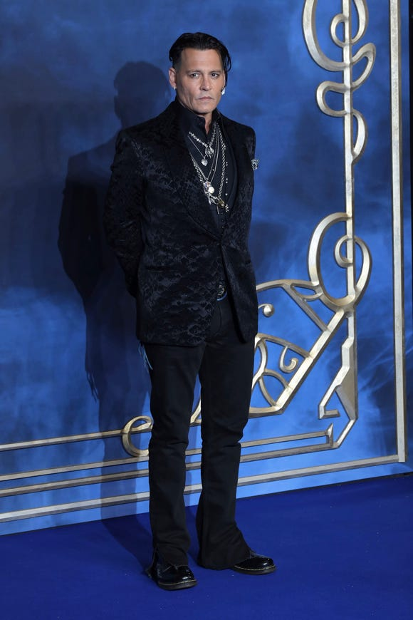 """Johnny Depp was in London for the premiere of """"The Crimes of Grindelwald,"""" after missing several other red-carpet events."""