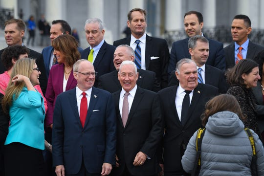 Greg Pence, R-IN, front center right, and John Rose, R-TN, front center left, along with Jim Baird, R-IN, front right, and the other newly-elected House Members of the 116th Congress gather at the U.S. Capitol for a class photo, Wednesday, Nov. 14, 2018, in Washington.