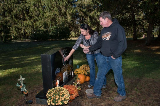 Pamela Ward and Kevin Ward Sr. visit the grave of son Kevin Ward Jr., located a few miles from their home in Port Leyden, N.Y.