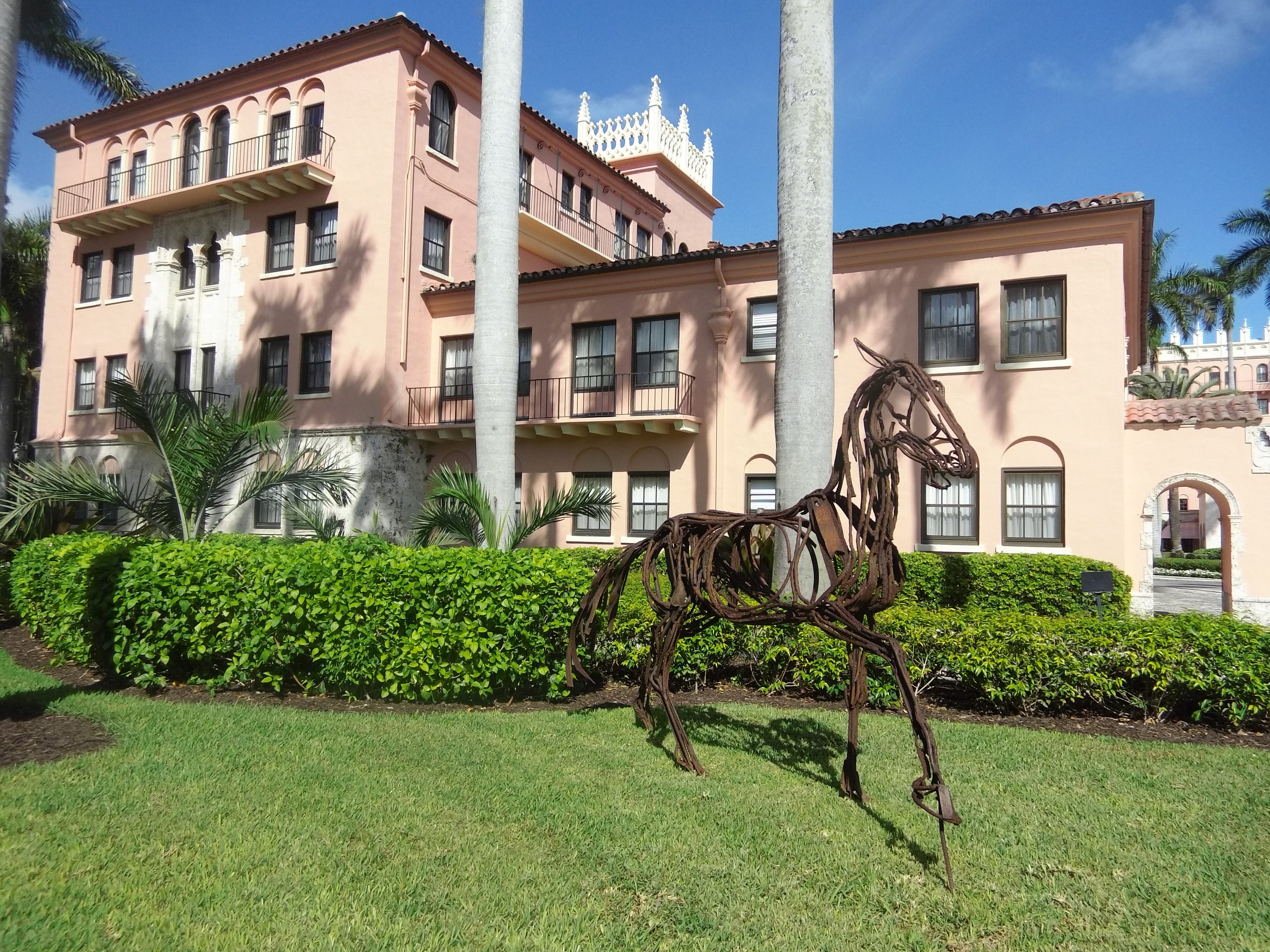 A sculpture, curated by Sponder Gallery, sits in front of the original Cloister Inn at Boca Raton Resort & Club.