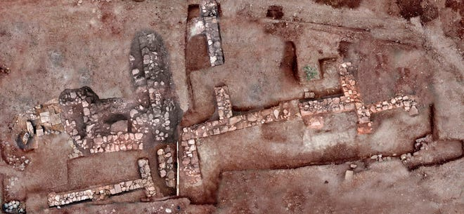 This undated photo provided by the Greek Ministry of Culture on Tuesday, Nov. 13, 2018, shows remains of walls and floors, probably from houses, from the lost ancient city of Tenea. The ministry said Tuesday archaeologists have located the first tangible remains of the city that, according to tradition, was first settled by Trojan war captives after the Greek sack of Troy.