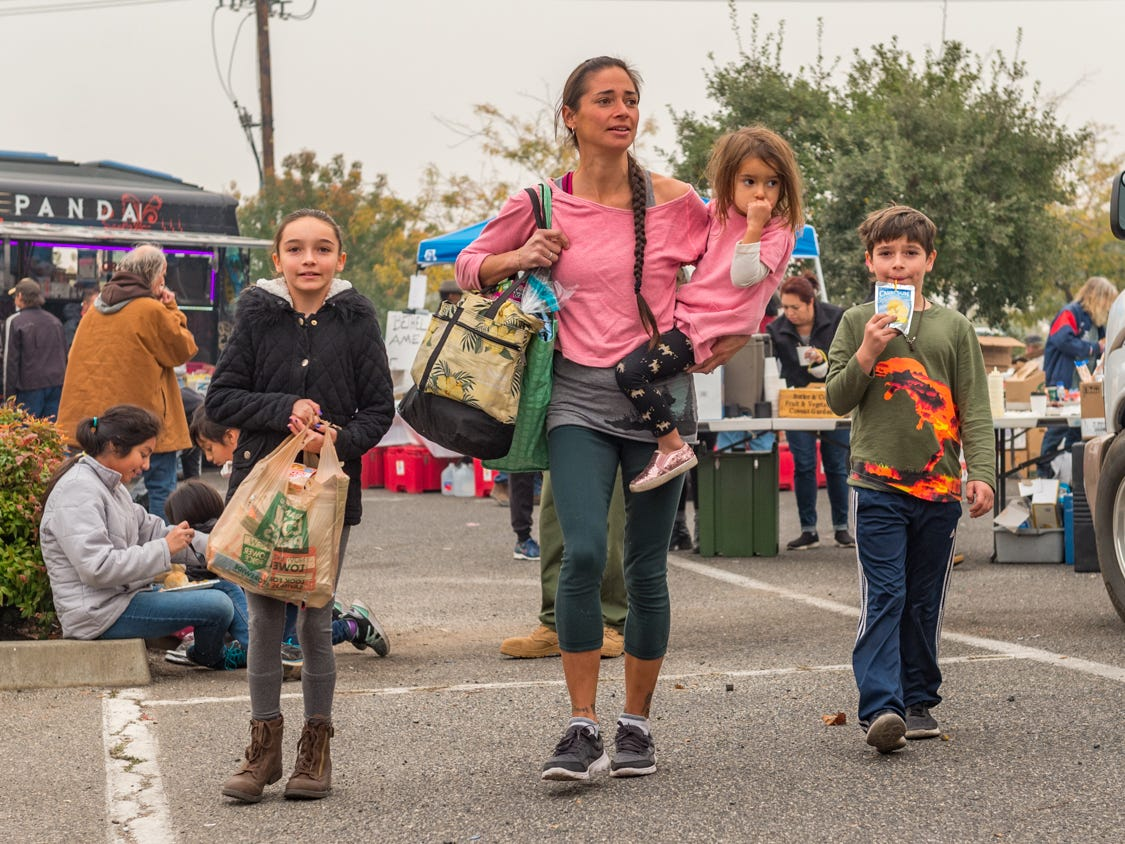 Jennifer Fuller with her children Sierra, Mary and Bear pick up supplies in Chico, Calif. on Nov. 13, 2018, after surviving the Camp Fire that destroyed their home in Paradise, Calif.