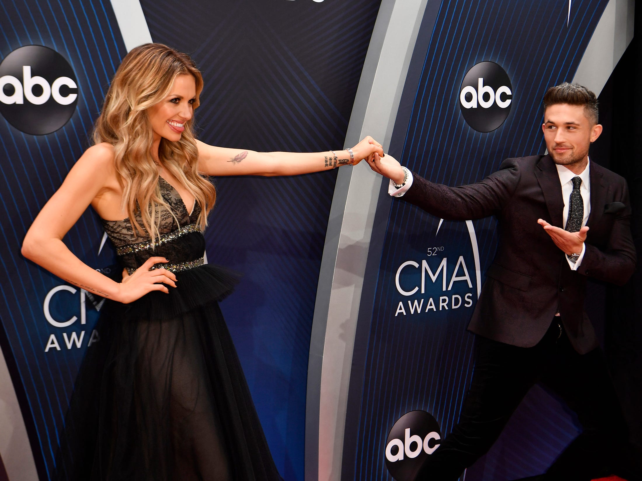 Carly Pearce and Michael Ray clown around on the red carpet.