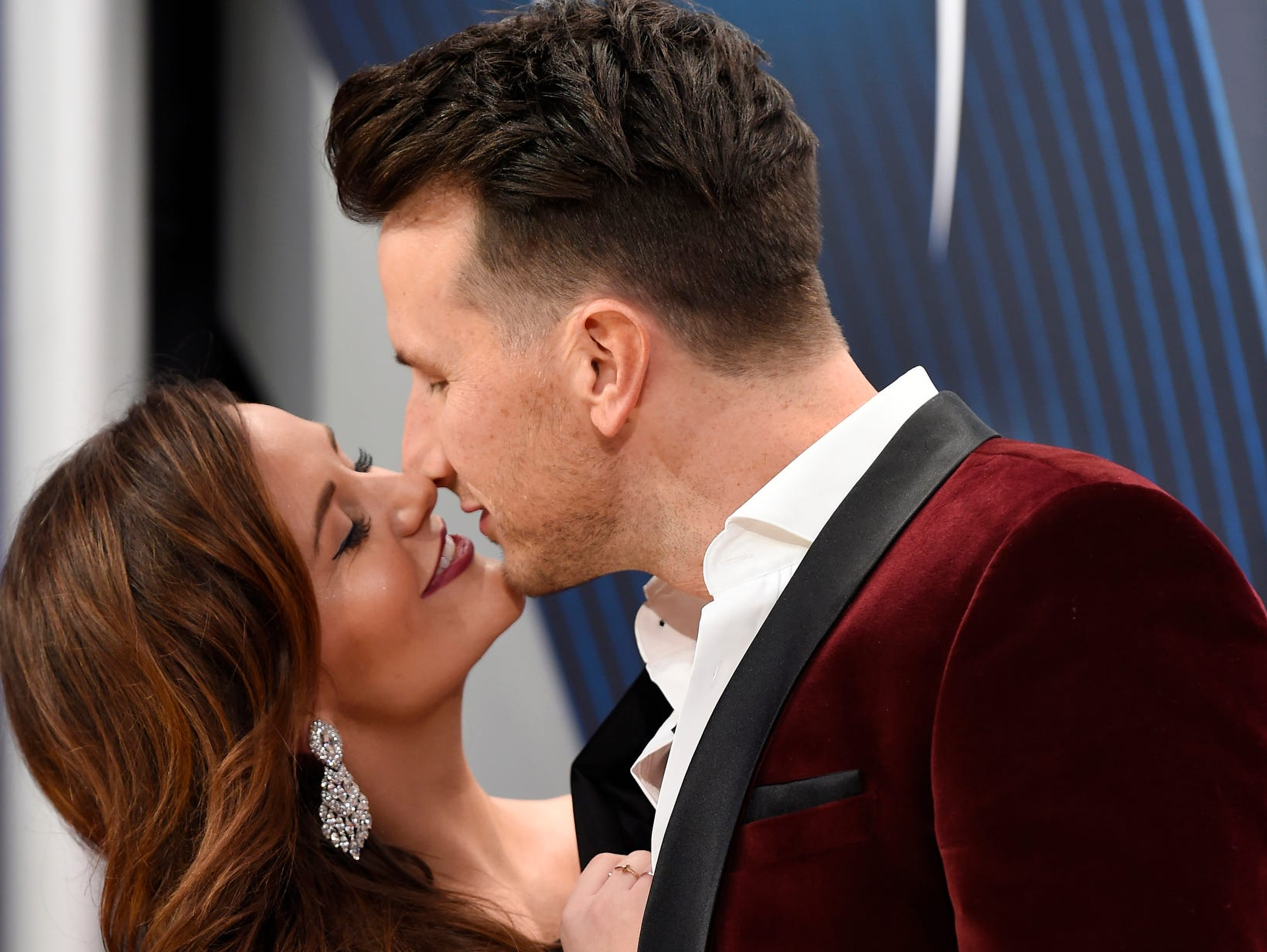 Russell Dickerson and wife Kailey snuggle on the red carpet.