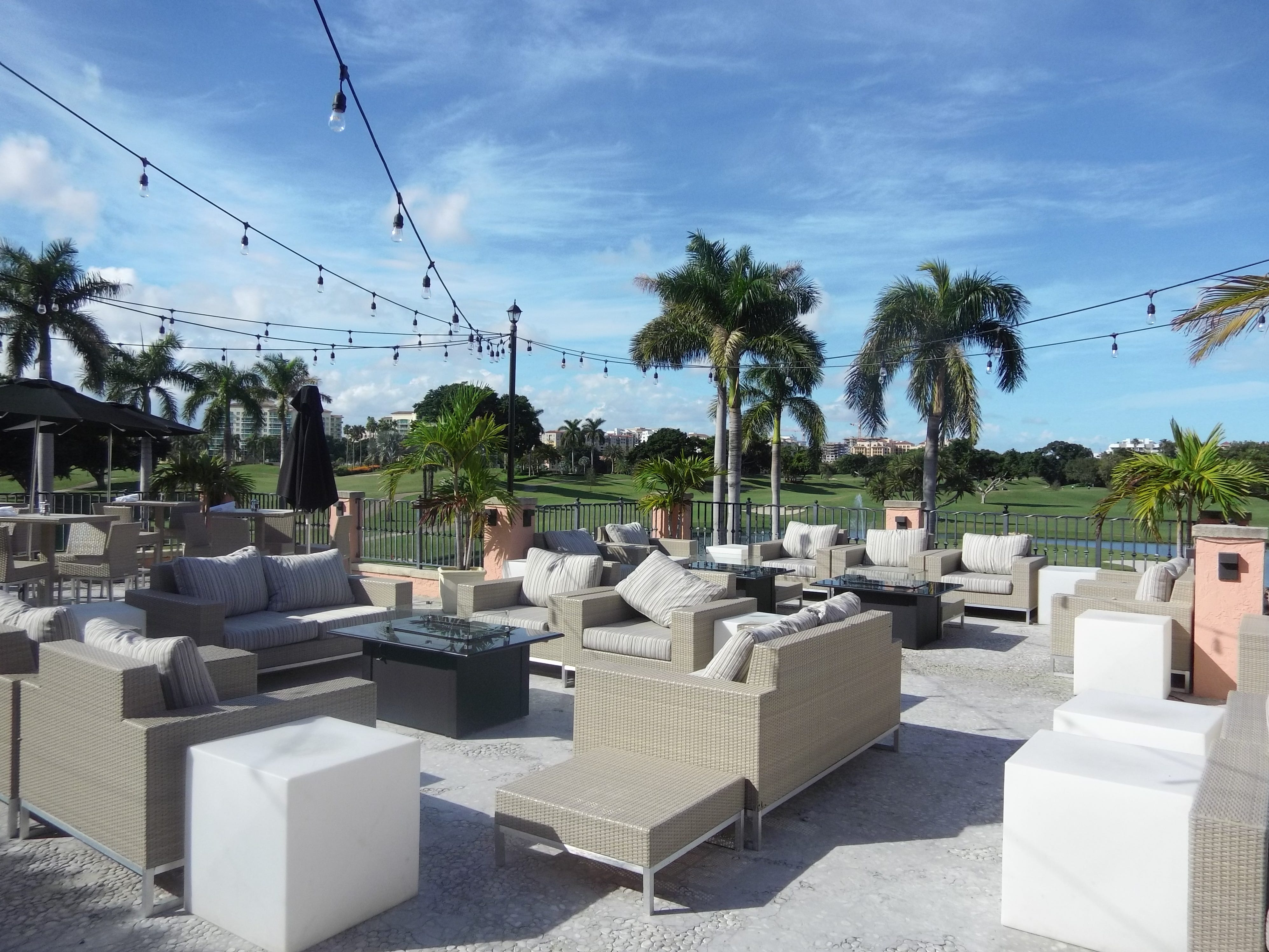 An outdoor seating area off the bar at 501 East Kitchen & Bar overlooks the resort's golf courses