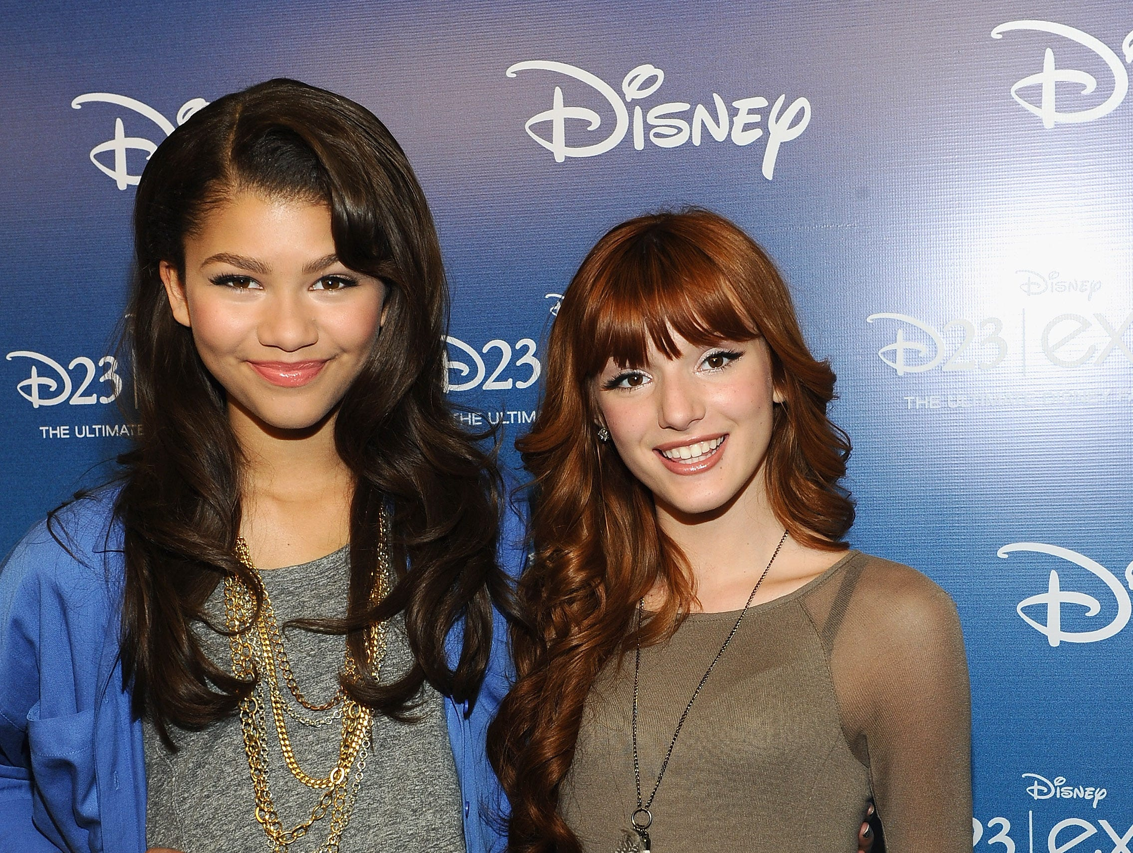 "ORG XMIT: 120673257 ANAHEIM, CA - AUGUST 21:  Actress Zendaya Coleman (L) and actress Bella Thorne arrive for the ""Shake It Up"" Panel during Disney's D23 Expo 2011 at the Anaheim Convention Center on August 21, 2011 in Anaheim, California.  (Photo by Michael Buckner/Getty Images) ORIG FILE ID: 121688941"